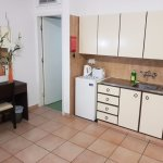 Kitchenette with cooker and cuttlery