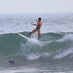 a youngster surfing at Kovalam beach