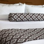 Sleep soundly in 7 layers of comfort with our upgraded bedding.