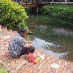 My son enjoying fishing with Mr. Kavi