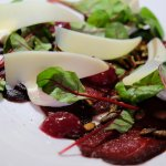 whale carpaccio with chevre cheese, lingonberry compote