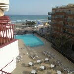 Overlooking the pool, beach and sea from room 315