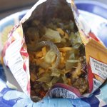 Frito Pie, served in the bag. Fritos topped with chili, cheese, onions & jalapenos