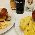 A couple of our delicious, home made burgers and a small selection of the spirits we have in hou