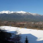 view of Pirin mountains and ski road from balcony of room 139