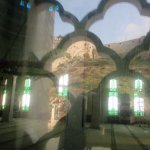 An interesting view of the inside of the mosque with a reflection of the hillside.