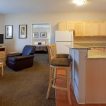 Two bedroom Suite featuring 1 king size bed and 2 queen size beds
