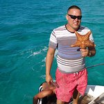 Knowledgeable crew on the catamaran found this starfish to show us, then put it back in the wate