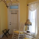 The Mary Ireland Room is yellow and white with pewter furnishings, private en suite bath.