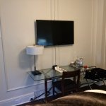 TV and glass table in Rm# 122