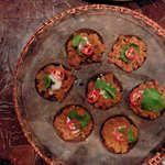 Trumpet mushrooms topped with a fine mince of pork, prawn and spices warmed with coconut cream s