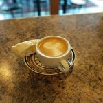 """Latte with """"Lobster Art"""" and a yummy Biscotti"""