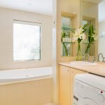 Executive king suite bathroom with washer and dryer