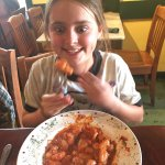 The lasagna and our oldest enjoying the Frutti Del Mar over gnocchi