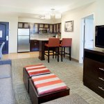 Living room area and kitchen in our 1 bedroom suites
