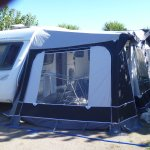 Our caravan and awning; note site is dog-friendly!!!