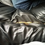 What's hiding the cracks of the couch...