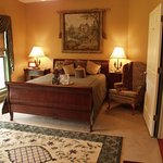 Gilded shades of the Warbler Suite with mahogany Ethan Allen furnishings and  whirlpool/fireplac