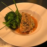 Pan fried fillet of salmon, topped with a lemon parsley crust, set on crushed new potatoes with