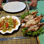 Grilled tiger prawns with tomato salad and dips
