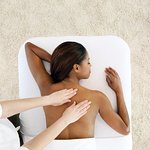 Massage can play a role in relieving respiratory issues and training the body how to relax.