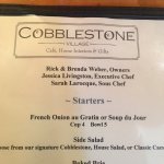 Cobblestone Village Cafe resmi