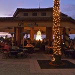 The Outdoor dining area & bar at CJ's at twilight time.