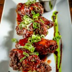 Our signature house wings that are Ryan & Wood smoked served with a taragon blue cheese dip.