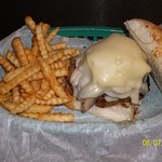 1/2 lb burger, hand pressed with a mound of mushrooms and 2 slices of swiss cheese.Mmmmmm great!
