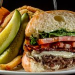 Our award winning Sin Burger with applewood smoked bacon, swiss cheese, truffle aioli,  herb fri
