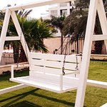 A bench swing located on the terrace grounds outside the hotel.