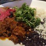 Cochinita pibil, chips, salsa and guacamole