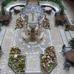 Lovely atrium with fresh, colorful flowers in the middle of winter