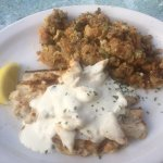 Red Snapper with lump crab meat in a cream sauce. Side was sage and sausage stuffing.