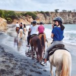 Riding through Playa Negra (black sand beach)