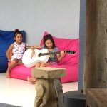 Serenade by two young girls practicing a song.