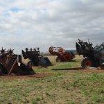 Buried Combines in an open field