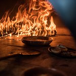 Dishes taste better when they are prepared on our specialized wood ovens