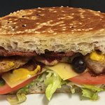 Our Club Sandwich - grilled chicken, bacon, cheese, cranberry, mustard & salad on a toasted turk