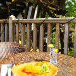 Outdoor seating on our decking beside our water wheel