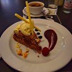 Chocolate Almond Cake with Americano at Suas