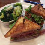 A well-packed BLT with a side of steamed brocolli.
