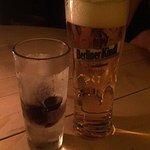 Jagermister shot served in a ice cold shot glass and a glass of Berliner Pilsner