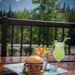Enjoy a Drake burger with breathtaking views of the Three Sisters mountains