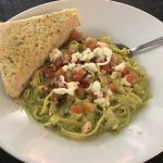 Pesto Chicken Fettuccine made with fresh pasta & a side of house made herb focaccia