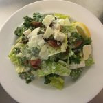 Bacon Kale Caesar Salad with house made bacon fat Caesar dressing & shaved asiago