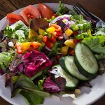 Try our Phoenix Signature Salad - a colorful blend of fresh field greens, cucumbers, purple onio