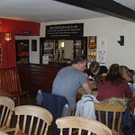 The Hare & Hounds at Stoughton is an attractive little country pub in the South Downs National P