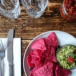 Holy Guac, Chipotle chips and salsa fuego. It's so good, rumour has it, it made Jesus cry