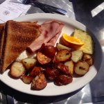 eggs over easy, ham, hash browns, toast
